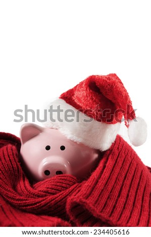 Pink piggy bank with a Santa Hat - stock photo