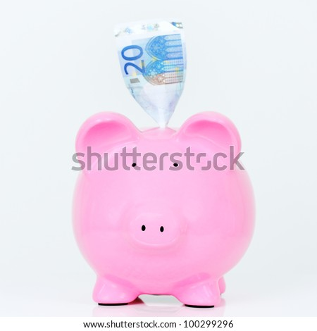 Pink piggy bank with bill isolated on white background