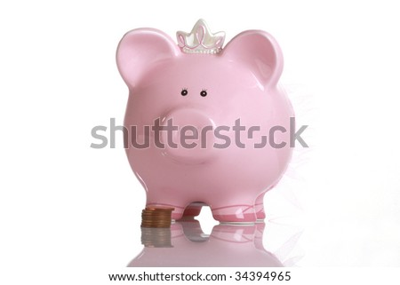 Pink Piggy Bank with coins - stock photo