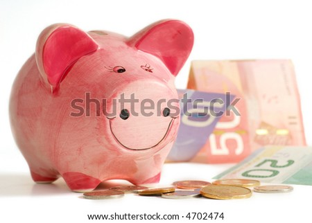 Pink piggy bank with coins and bills