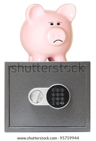 Pink piggy bank with safe - stock photo