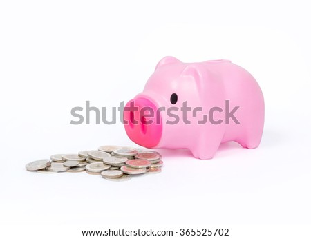 Pink Piggy bank with stack of coins on white background