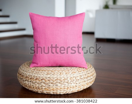 Pink pillow in white interior. Decorative pillow for home decor. Accent pillow in interior. - stock photo