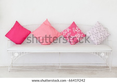 Pink pillow on the chair with white - stock photo