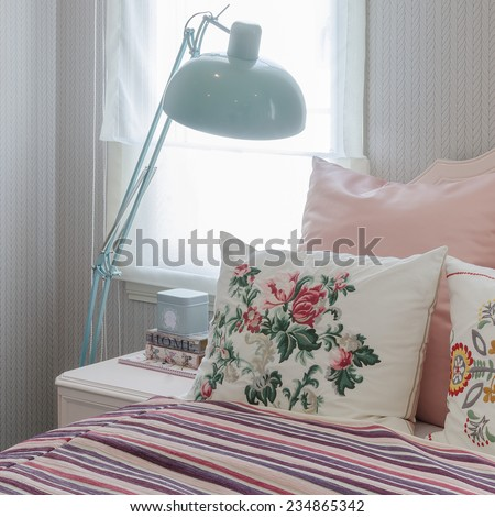 pink pillows on bed in bedroom - stock photo