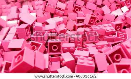 Pink plastic Lego blocks - stock photo
