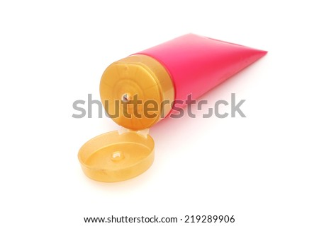 pink plastic tube with opened yellow  flip top lid  for cosmetic on white background - stock photo