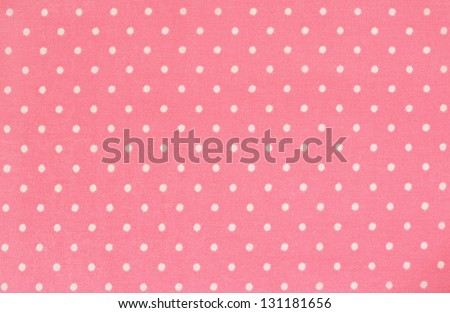 Pink polka dot fabric for background - stock photo