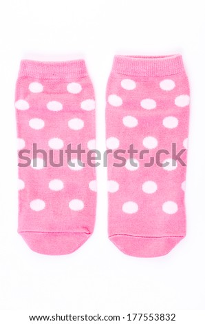 Pink polka sock on isolated white background