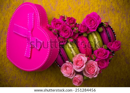 pink present box heart shape with flowers and macaroons yellow background for valentines mother day easter with love - stock photo