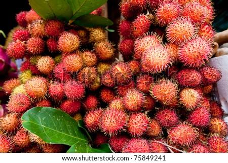 Pink Rambutan in a Street Market in Cambodia - stock photo