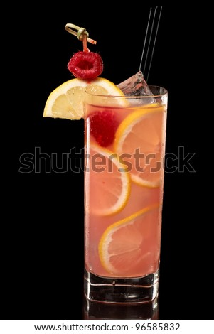 pink raspberry lemonade isolated on a black background garnished with lemon and red raspberry, tall glass - stock photo