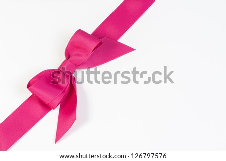 Pink ribbon and bow isolated on white - stock photo