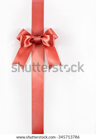 Pink ribbon with pink ribbon bow isolated on white
