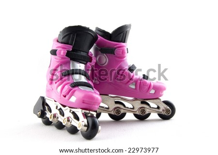 pink rollerskates isolated on a white background - stock photo