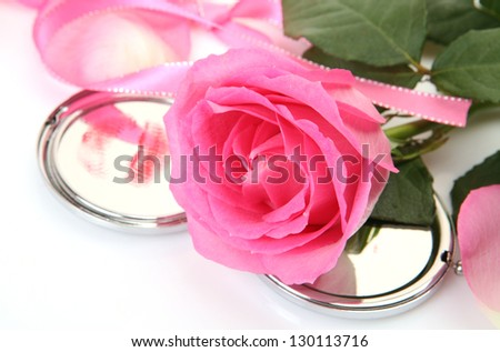 Pink rose and mirror