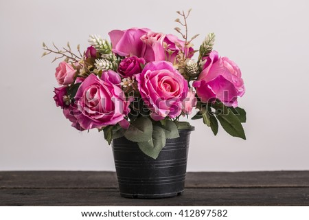 Pink rose flower on table