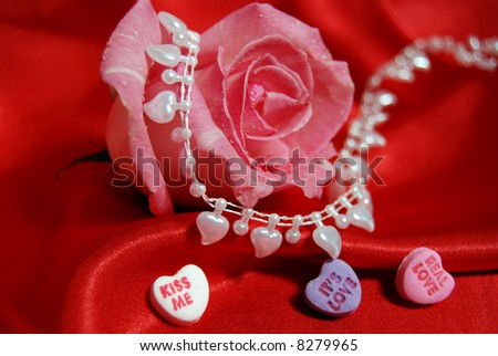 pink rose,pearl heart and candy - stock photo