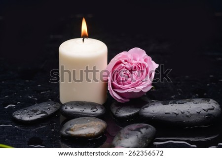 pink rose with candle and therapy stones  - stock photo