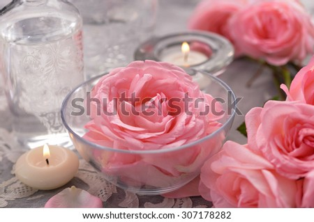 Pink rose with candle on lace - stock photo