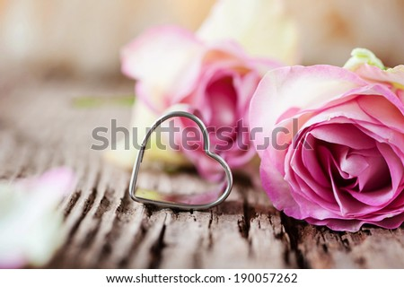 Pink roses and a sweet little heart - stock photo