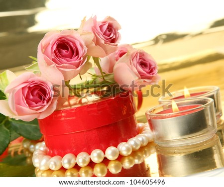 Pink roses and candles - stock photo
