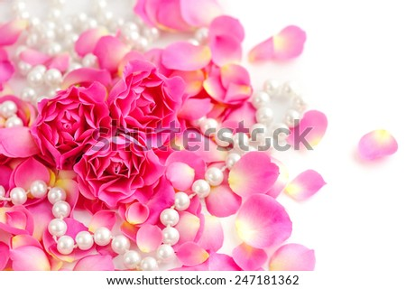 Pink roses and pearls on white background - stock photo