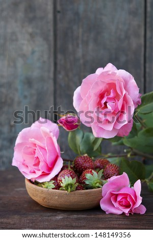 pink roses and strawberries still life - stock photo