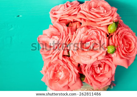 Pink roses in vase. Flowers beautiful bouquet of roses on vintage background.  - stock photo
