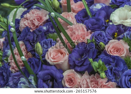 Pink Roses, purple Lisianthus and pearls on greens - stock photo