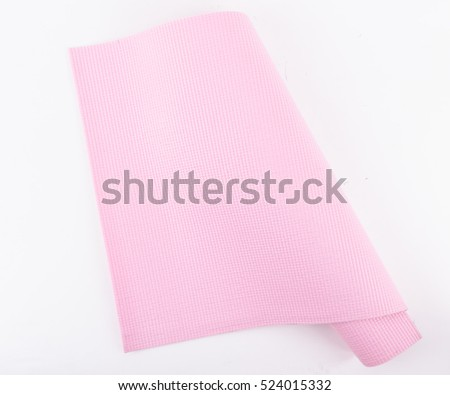 Pink rubber texture material of yoga mat for sport, fitness, exercise, gym and lifestyle equipment on white background.