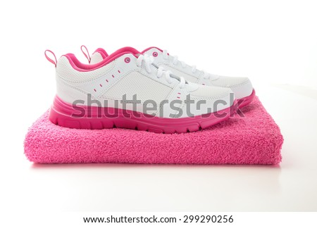 pink running shoes after workout sweaty towel - stock photo