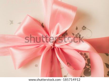 pink satin gift bow. Ribbon. Isolated on white - stock photo