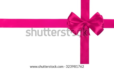 Pink satin ribbon with bow isolated over white background