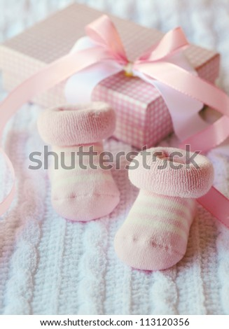 Pink shoes for newly born baby girl. Greeting card, baby shower, birthday card. Vertical with copy space. - stock photo