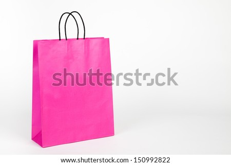 Pink shopping bag on white (with space for your logo or text) - stock photo