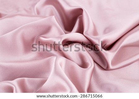 Pink silk fabric for background. - stock photo