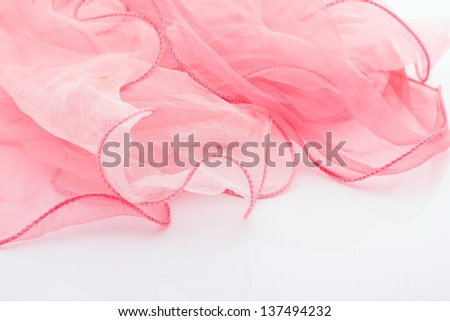 Pink silk scarf isolated on the white background.