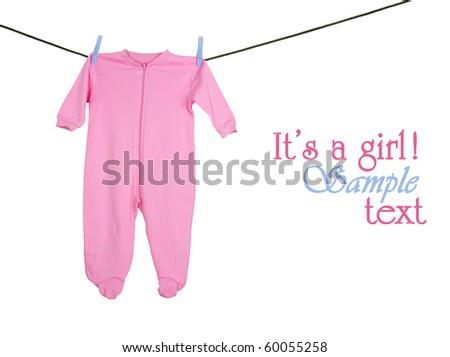 Pink sleeper hanging on the clothesline, studio isolated on white. - stock photo