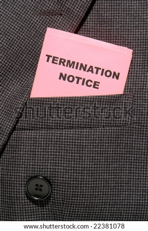 Pink slip termination notice folded in an executive business man suit breast pocket - stock photo