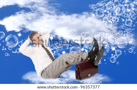 Pink soap dreams of a happy life of the businessman sitting on a fluffy white cloud - stock photo
