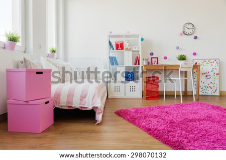 Pink soft carpet in modern children room - stock photo