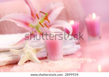 Pink soothing spa feeling with flower and pink candles - stock photo