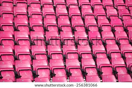 Pink Spectators seats at a stadium - stock photo