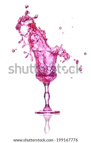 Pink splash out drink from glass on a white background. - stock photo