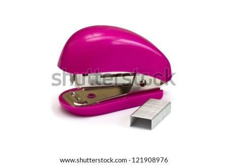 Pink stapler isolated on white background - stock photo