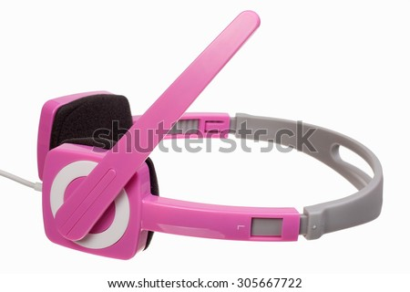 Pink stereo headphones isolated on white background - stock photo