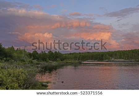 Pink Storm Clouds at Sunset on Kawnipi Lake in Quetico Provincial Park in Ontario