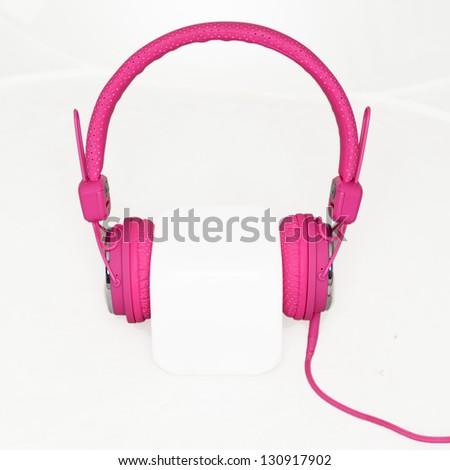 pink stylish headphones - stock photo
