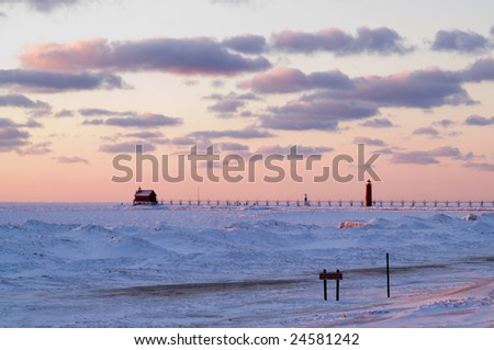 Pink sunset at Grand Haven, MI - stock photo